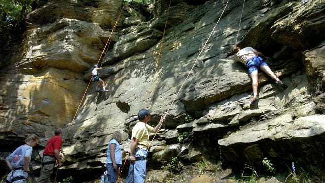 Climbers with varying degrees of experience climb at The Ledges in Grand Ledge.