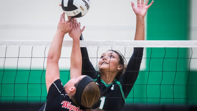 Yorktown's Kenzie Knuckles blocks a hit from Wapahani during their game at Yorktown High School Tuesday, Aug. 29, 2017.