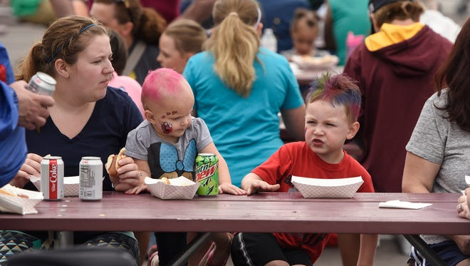 People enjoy lunch in June 2018 at the Libertyville block party as part of Sartell Summerfest celebrations.