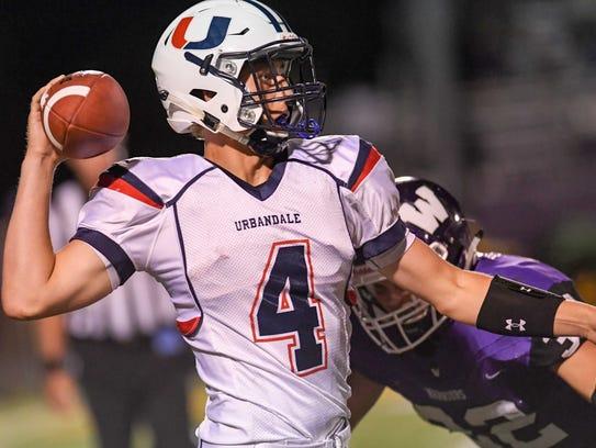 Urbandale Quarterback Luke Llewellyn (4) scrambles