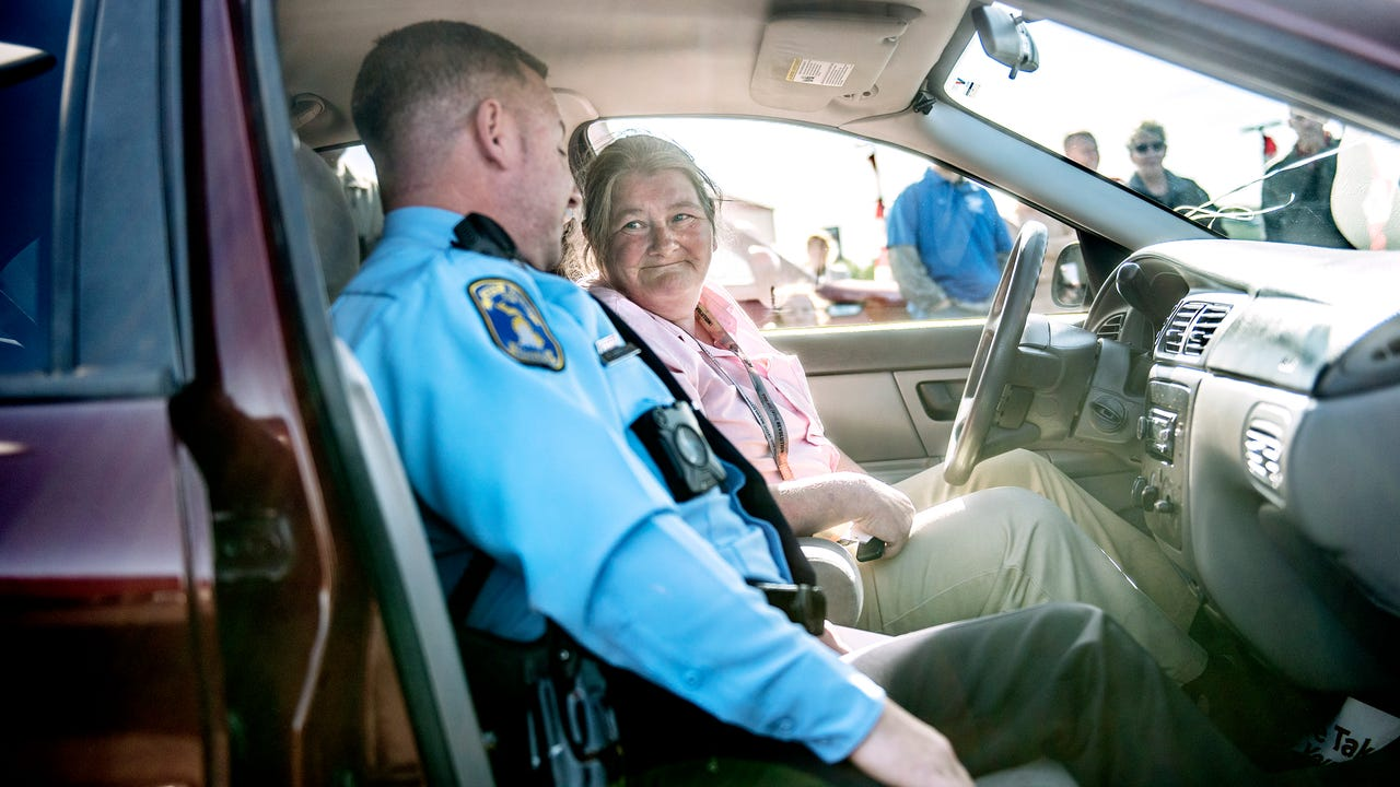 Lansing resident Jo Meade was gifted a new used car on Tuesday, Oct. 17, 2017, at the Kia of Lansing car dealership. Lansing Police Officer Trevor Arnold set up the surprise after learning that Meade had to bike 16 miles round trip to and from work.