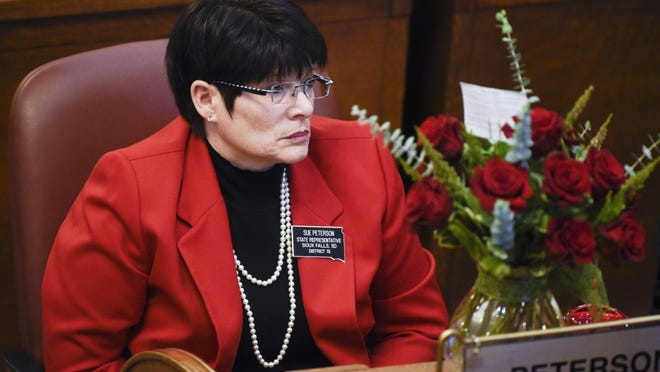 Rep. Sue Peterson (R-Sioux Falls) sits at her desk in the South Dakota House of Representatives on Jan. 9, 2018 in Pierre, S.D.
