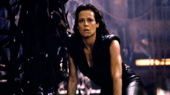 Ripley (Sigourney Weaver) is reborn as a human/alien
