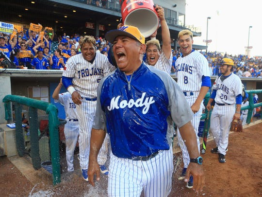 Moody's head coach Joe Curiel gets splashed by his players after defeating Ray 3-2 in game 2 of the Region IV-5A finals Friday, June 2 ,2017, at Whataburger Field in Corpus Christi.