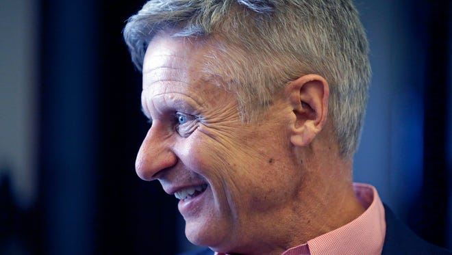 "In this May 18, 2016 fie photo, Libertarian presidential candidate, former New Mexico Gov. Gary Johnson speak with legislators at the Utah State Capitol in Salt Lake City. He has virtually no money, no strategy to compete in battleground states and no plan to stop talking about his drug use. Yet with the Republican Party facing the prospect of a Donald Trump presidency, Libertarian presidential hopeful Gary Johnson could be a factor in 2016. The former two-term New Mexico governor, a Republican businessman perhaps best known for his years-long push to legalize marijuana, has a sobering message for a ""never-Trump"" movement desperately seeking a viable alternative."