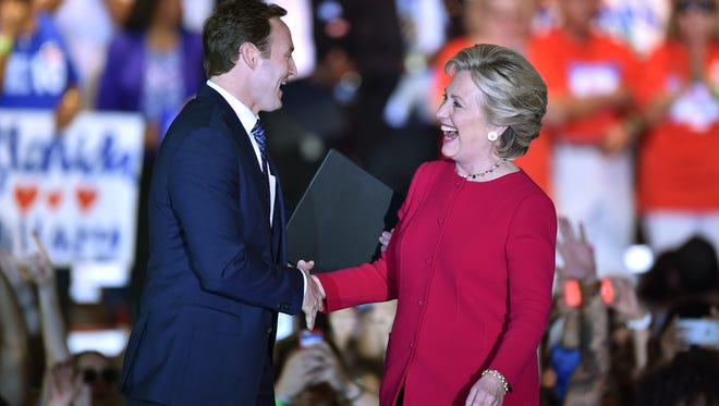 Congressman Patrick Murphy introduces Hillary Clinton before speaking to her supporters during her Early Voting Rally, campaigning at Broward College on Tuesday, Oct. 25, 2016, in Coconut Creek.