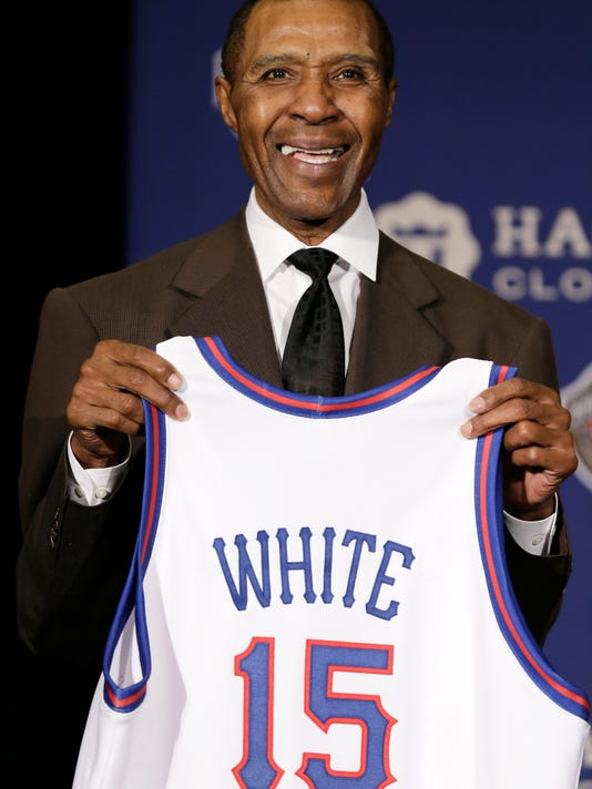 FILE - In this Monday, April 6, 2015 file photo, Former NBA player Jo Jo White stands on stage during the Naismith Memorial Basketball Hall of Fame class of 2015 announcement in Indianapolis. Basketball Hall of Famer Jo Jo White, a two-time NBA champion with the Boston Celtics and an Olympic gold medalist, has died. He was 71. The Celtics announced his death Tuesday, Jan. 16, 2018. No cause was provided. (AP Photo/Charlie Neibergall, File)