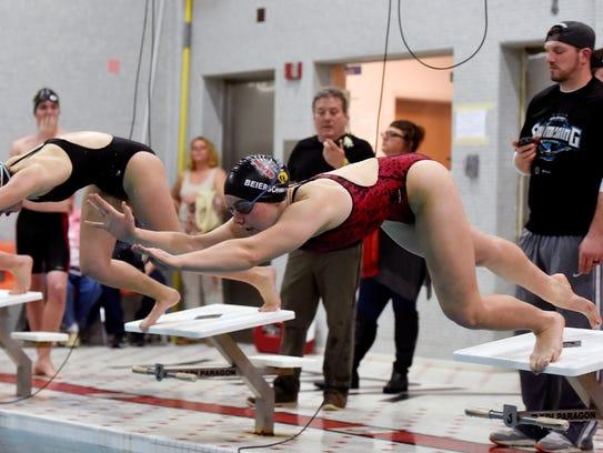 Dover's Grace Beierschmitt dives off the block for