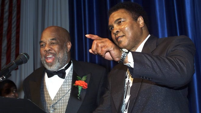 After David Wells pulled out as the headliner, Muhammad Ali saved the day with his appearance at the Rochester Press-Radio Club Day of Champions Dinner on Jan. 25, 1999. Howard Bingham, one of Ali's best friends, was receiving the Eastman Kodak Vision Award and reached out to Ali to see if he could attend.