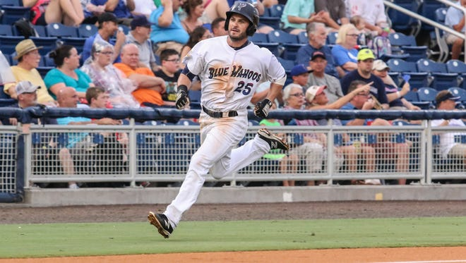 Pensacola's Beau Amaral scores on an RBI single by Sebastian Elizalde Thursday night at Blue Wahoos Stadium.