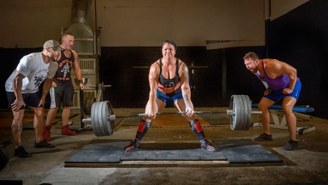 Ana Perez dead lifts 425 pounds - more than twice her body weight - during a workout in Virginia. MUST CREDIT: Photo by Doug Kapustin for The Washington Post.