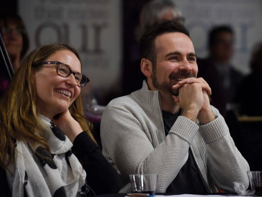 Attendees laugh during the Storytellers event.