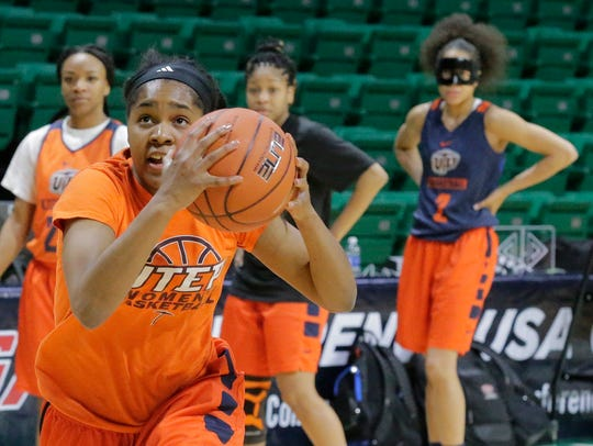 UTEP junior guard Sparkle Taylor drives to the basket