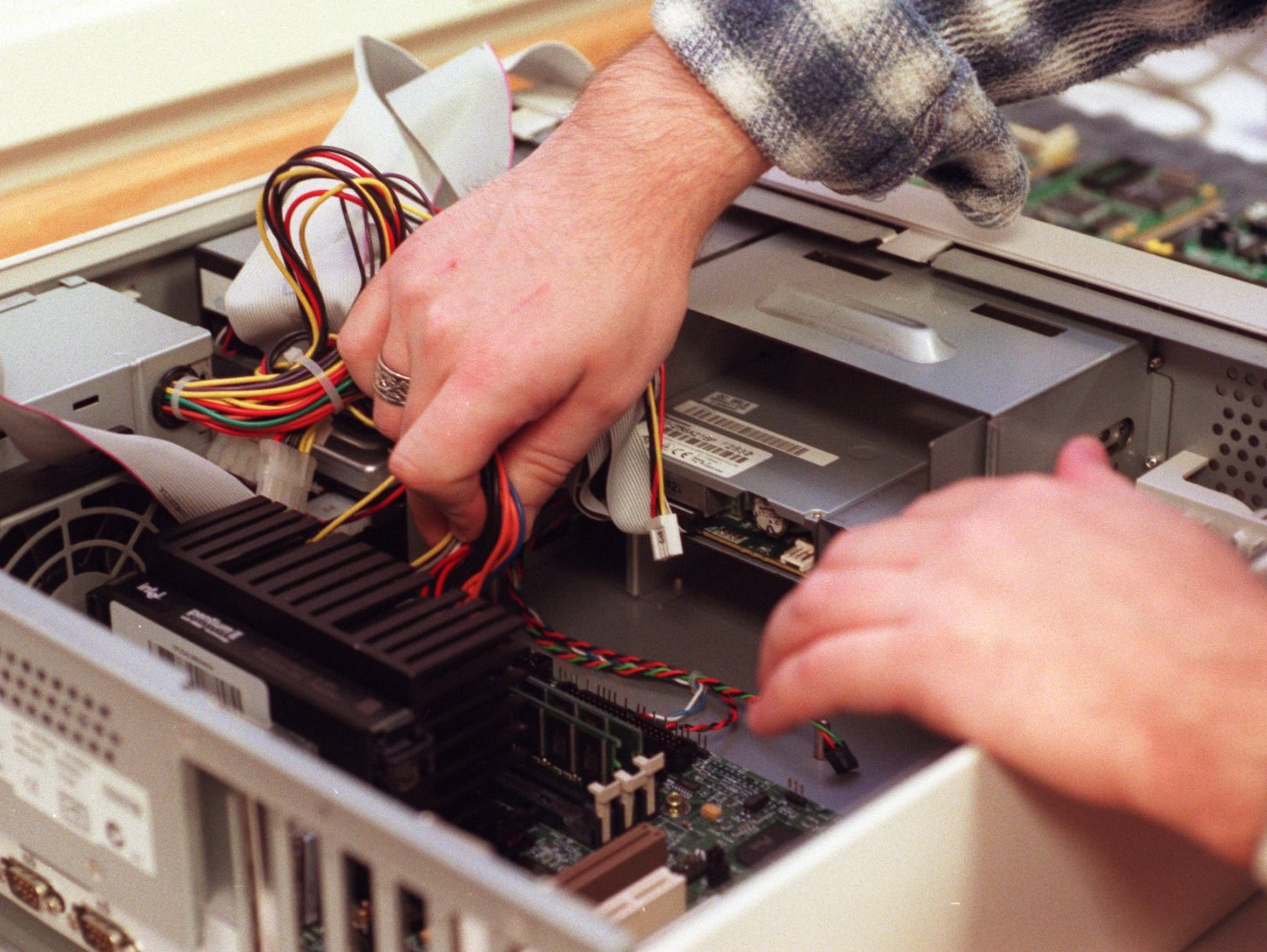 In this file photo, Eric Means updates the bios chip