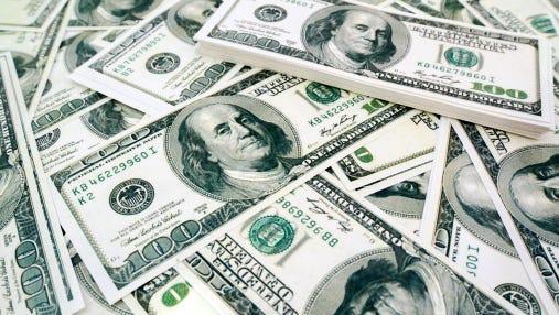 One hundred US dollar bills pile