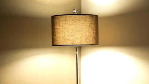 The bolt that holds a lampshade to a lamp is the same size threading as the tripod mount on a camera.