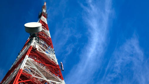 Telecommunication Tower on blue sky and clouds