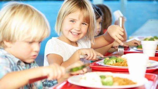 Children enjoy lunch