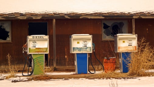 Gas pumps showing decades old prices per gallon
