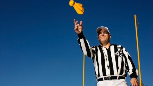 Referee Tossing Penalty Flag
