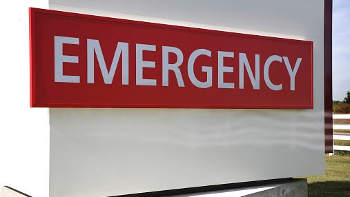 Red and white emergency sign