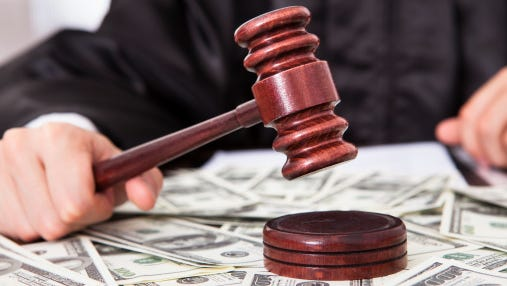 Judge Hitting Mallet On Dollar