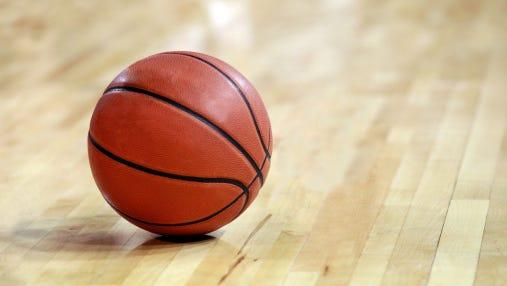 Basketball on Hardwood Floor