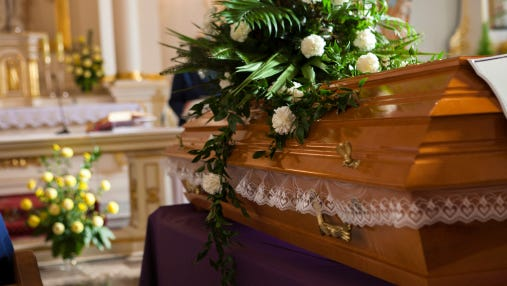 Flowers on a coffin in a church