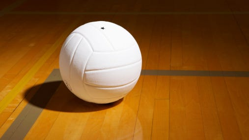Volleyball on indoor volleyball court, elevated view