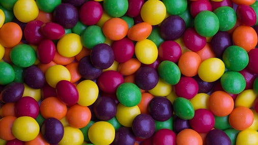 Coated multicolored candy