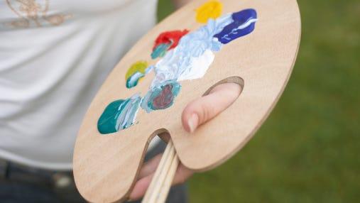 Woman holding painter's pallet