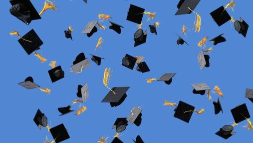Graduation caps thrown into air