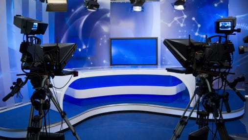TV studio with camera and lights