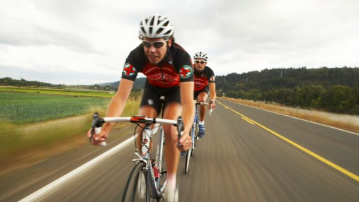 Road cyclists in action on country road