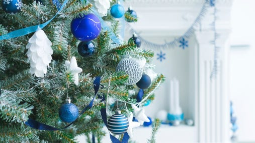 If you're looking to repurpose your Christmas tree for your backyard birds, make sure you take off all tinsel and ornaments first.