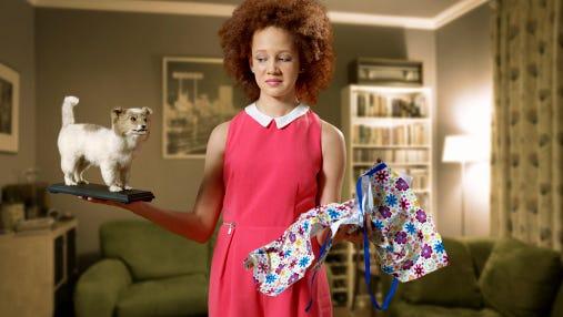 Young girl with stuffed dog gift.