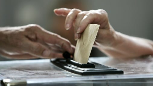 Close-up on a woman casting her ballot .