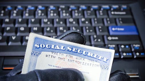 Social Security card and laptop.