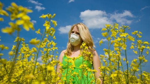 Some allergy sufferers don masks to reduce their intake of allergens.