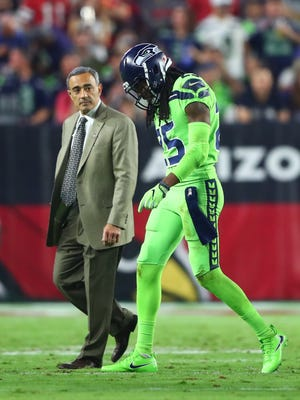 Nov 9, 2017; Glendale, AZ, USA; Seattle Seahawks cornerback Richard Sherman (25) leaves the field with a doctor after suffering an injury in the second half against the Arizona Cardinals at University of Phoenix Stadium. Mandatory Credit: Mark J. Rebilas-USA TODAY Sports