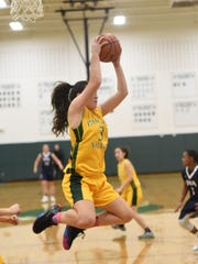 Pascack Valley #3 Kelly Smith grabs a rebound Girls basketball game between Pascack Valley and IHA in the championship game of the Joe Poli Holiday Tournament