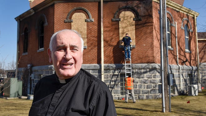 Bishop Donald Kettler came to see the damage Saturday, March 12, from a fire at the Church of St. Mary on Friday night in Melrose.