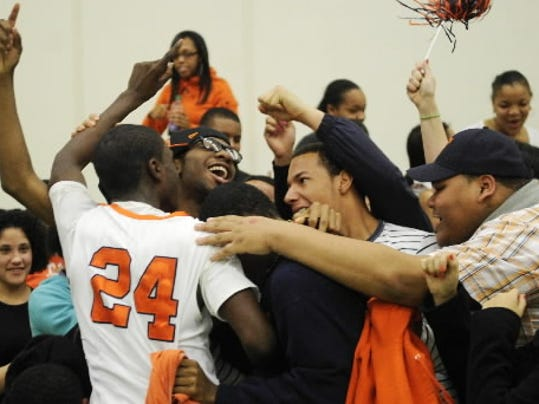 Tavon Parker celebrates after William Penn's YAIAA tournament title win last season. (DAILY RECORD/SUNDAY NEWS -- FILE)