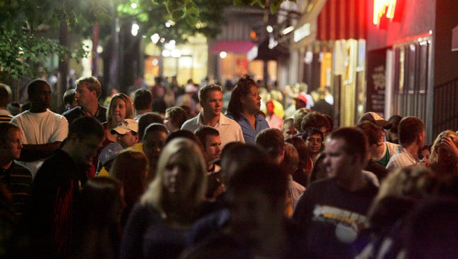 In this file photo, people fill up the pedestrian mall in downtown Iowa City following last call in the nearby bars.