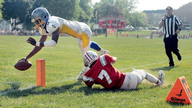 Irondequoit's Fredrick June, left, dives for the pylon over Canandaigua's Mitchell Pfeiffer during a regular season game played at Evans Field on Sept. 10, 2016.