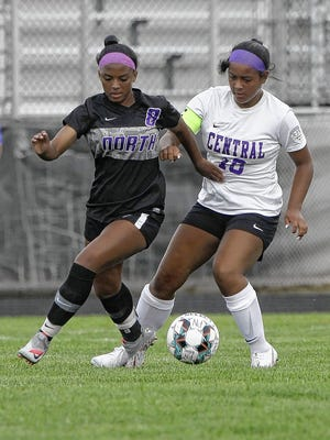 Central's Kassidy Stanley battles North's Avery Bowden for the ball Aug. 21. Stanley is helping to lead a deep group of midfielders for the Tigers.