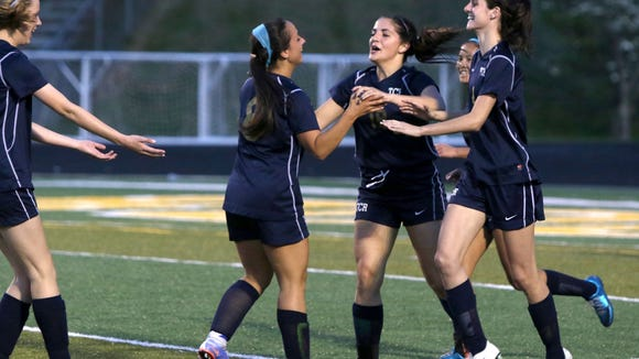 Roberson players celebrate a goal Monday night at Reynolds.