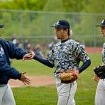 Richmond's Matt Skoryanc fields the ball during a baseball game Tuesday, May 19, 2015 at Armada High School.