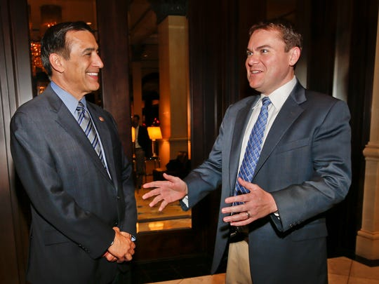 Carl DeMaio, right, speaks to Republican Rep. Darrell Issa, left during the 2014 election, when Demaio ran in the California's 52nd Congressional District in this file photo.