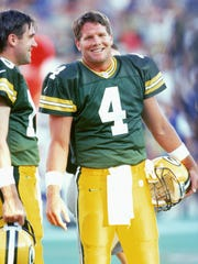 Green Bay Packers quarterback Brett Favre (4) and back up quarterback Doug Pederson (18) look on during an NFL preseason football game against the New York Giants at University of Wisconsin's Camp Randall Stadium on August 22, 1997 in Madison, Wisconsin.  The Packers won 22-17.